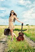 stock photo of hippy  - Romantic girl travelling with her guitar - JPG