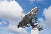 stock photo of telecommunications equipment  - Big radar parabolic radio antenna global telecommunication technology equipment for information data streaming broadcast - JPG