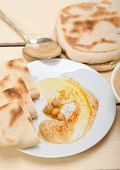 pic of pita  - traditional chickpeas Hummus with pita bread and paprika on top - JPG