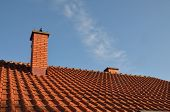 picture of roof tile  - Tiles and chimney on the roof on a sunny day  - JPG