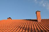 stock photo of roof tile  - Tiles and chimney on the roof on a sunny day  - JPG