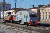 foto of locomotive  - The locomotive is on the tracks near the railway station - JPG