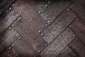 stock photo of timber  - background made of weathered old wood timber planks with rivets - JPG