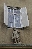 foto of cherub  - Cherub sculpture on facade under window - JPG