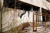 picture of reactor  - Graffiti on abandoned central square in Pripyat ghost town Chernobyl Nuclear Power Plant Zone of Alienation Ukraine - JPG