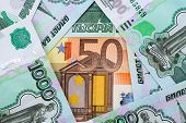 picture of depreciation  - background 50 Euro and 1 - JPG