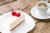 foto of wood pieces  - New York style cheesecake with cup of coffee on wood background - JPG