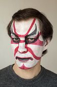 image of face painting  - Severe man with face painting kabuki black red and white color - JPG