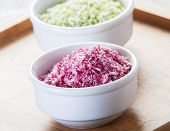 picture of naturist  - sweetened Coconut Flakes pink close up in white bowl - JPG