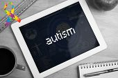 image of autism  - The word autism and autism awareness ribbon against medical biology interface in blue - JPG