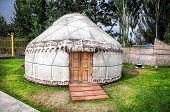 image of nomads  - Urta nomadic house on the green grass in Ruh Ordo complex near Issyk Kul lake Kyrgyzstan - JPG
