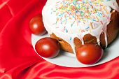 foto of no clothes  - Easter cake and painted eggs on red cloth closeup - JPG