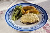 foto of cheese-steak  - Moose steak with cheese on top and potatos andn haricots verts - JPG