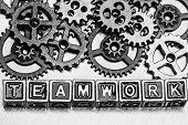 pic of teamwork  - Teamwork concept Word teamwork with cog wheels on metal background - JPG