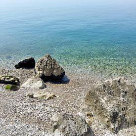 picture of naturist  - A sunny day in a Stunning Naturist Beach in Trieste Italy  - JPG