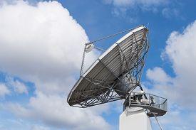 foto of telecommunications equipment  - Big radar parabolic radio antenna global telecommunication technology equipment for information data streaming broadcast - JPG