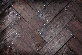 picture of timber  - background made of weathered old wood timber planks with rivets - JPG