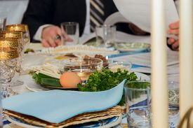 foto of seder  - seder table with passover plate and special meal with egg parsley - JPG
