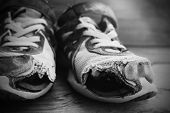 Постер, плакат: Old shoes with holes worn down shabby for homeless clothing