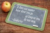 It does not matter how slow you go as long as you don not stop - Confucius quote on persistence- wor poster