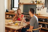 Постер, плакат: Couple Having Chat At Breakfast Table