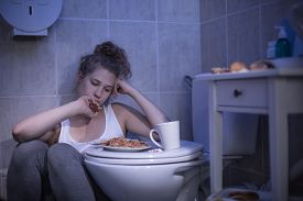 image of bulimic  - Image of woman with fixation on number of calories consumed - JPG