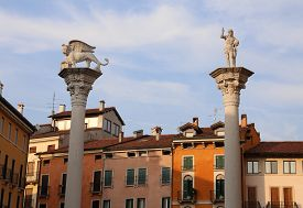 stock photo of vicenza  - Vicenza Italy Two columns with Winged lion and Jesus Redeemer with the world in your hand - JPG