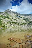 Landscape With Glacial Lake And Rocks At National Park Pirin