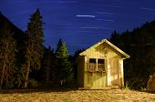 Star Trails And A Mountain Hut At National Park Pirin