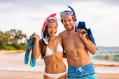 Healthy lifestyle fit body beach snorkel couple with diving masks and fins. Bikini swim models in sw poster
