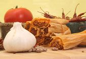 stock photo of chipotle chili  - Garlic with Tamales and Beans on Yellow Background - JPG
