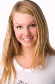 A Smiling Blonde On White Background In Studio.