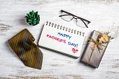 Happy Fathers Day Concept. Flat Lay Image Of Gift Box, Necktie, Glasses And Notebook With Happy Fat poster