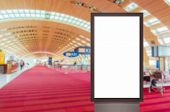 mock up of vertical blank advertising billboard or light box showcase with people waiting at airport poster