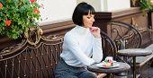 Woman Attractive Elegant Brunette Enjoy Dessert And Coffee Cafe Terrace Background. Dessert Concept. poster