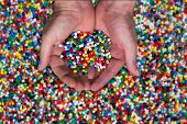 stock photo of thermoplastics  - plastic granules or plastic beats for children to play with - JPG