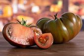 Group Of One Whole One Half One Slice Of Fresh Tomato Primora In A Rustic Kitchen poster