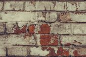 Texture Of Dilapidated Brick Wall Close Up. Dirty Shabby Brick Wall In White Peeling Paint. White Br poster