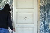 Man Opening Door Of Decayed Room