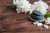 Pyramids Of Gray Zen Pebble Meditation Stones With Green Leaves, White Flowers And Buddha Statue On  poster
