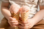 Ice Cream In The Hands Of A Child. A Happy Boy Is Holding Two Pink Ice Cream Cones In A Waffle Cup. poster
