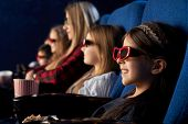 Row Of People In Cinema Sitting, Watching Movie Or Cartoon. Cute, Pretty Girl Wearing In 3d Glasses  poster