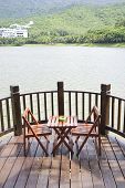 Patio with table and chairs by the lakeside.