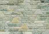 image of trapezoid  - pattern color of modern style design decorative green slate stone wall surface with cement in trapezoid shape - JPG