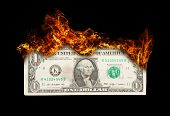 Burning Dollar Bill Symbolizing Careless Money Management