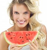 portrait of attractive  caucasian smiling woman isolated on white studio shot eating watermellon