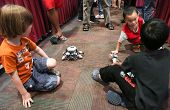 SUBANG JAYA - NOV 10: Unidentified visitors interact by playing with robots at the World Robot Olymp