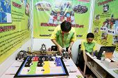 SUBANG JAYA - NOV 10: Unidentified students from Malaysia shows an intelligent robot that could iden