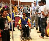 SUBANG JAYA - NOVEMBER 10: An unidentified student tests a wheel-chair robot at the World Robot Olym