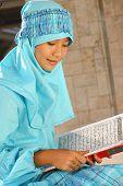 Muslim Child Readin Koran